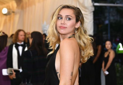 Miley Cyrus is really enjoying London as she gets handsy with her assistant
