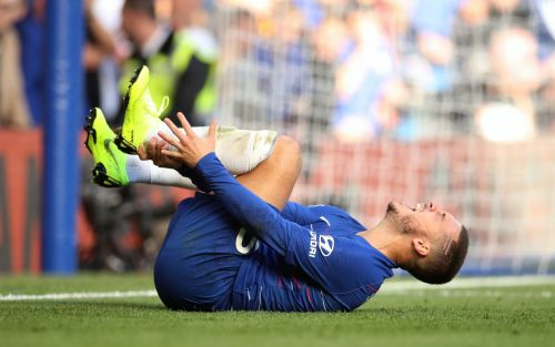 Eden Hazard complains of back pain and is a Champions League doubt after Manchester United fouls