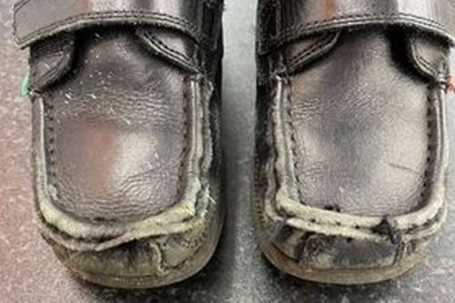 Mum demands refund after son's shoes left in tatters