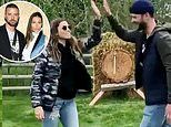 Justin Timberlake and Jessica Biel practice their 'apocalypse skills' by throwing axes