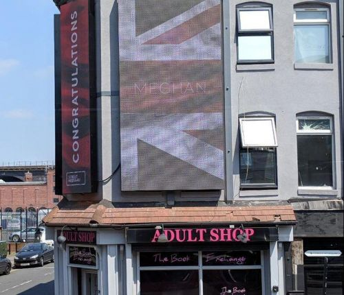 MP calls out advert above sex shop congratulating Harry and Meghan