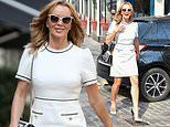 Amanda Holden puts on a leggy display in chic white dress