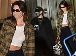 Kendall Jenner flashes her abs as she and pal Hailey Bieber arrive at Milan Fashion Week
