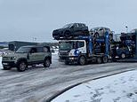 Land Rover Defender tows a 44-tonne transporter with 7 SUV out of ice