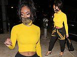 Saweetie showcases her toned abs in a yellow cropped sweater for a seafood dinner at Catch LA