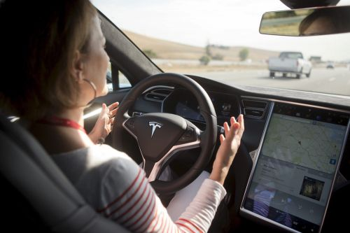 Videos of Tesla's new 'full self-driving' software look futuristic -but show just how far it is from full autonomy