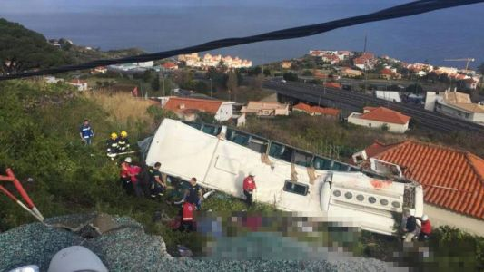 Madeira bus crash - At least 28 dead after tourist coach topples off mountain road and crashes into house