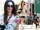 Emily Ratajkowski looks sporty in Spandex and a graphic T-shirt while walking Colombo in NYC
