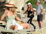 Kate Hudson enjoys a glass of wine as she relaxes during Greece family holiday