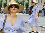 Maggie Gyllenhaal steps out in summer chic blue dress with straw hat after lunch in New York City