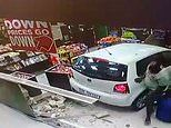 Video shows speeding car plough into busy petrol station as shoppers miraculously escape death