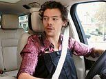 Harry Styles mocks his own quirky style sense as he dons a pair of HUGE trousers