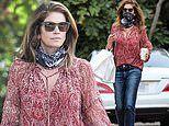 Cindy Crawford steps out with casually chic look while picking up food from Cafe Habana restaurant