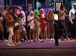Drinkers pack into pubs and clubs after a day on beaches - but where's the social distancing?