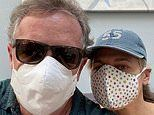 Piers Morgan and his wife Celia Walden don face masks as they enjoy romantic evening