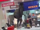 Burger King thieves hurdle counter to pinch food before one gives a meal to a homeless man