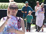 Kate Hudson cradles daughter Rani as she goes on family Sunday walk with beau Danny and son Bingham