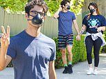 Darren Criss holds hands with wife Mia Swier as couple takes a stroll in LA wearing face masks