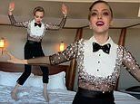 Amanda Seyfried dons dazzling tuxedo look as she jumps on the bed ahead of Critics' Choice Awards