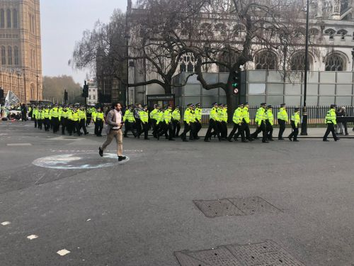 Extinction Rebellion protests: Dramatic pictures show scores of police officers marching in line to Parliament Square to remove eco warriors