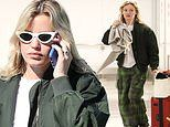 Georgia May Jagger goes casual in bomber jacket and checked trousers as she catches flight to LAX