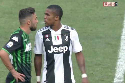 Douglas Costa breaks his silence after sickening spitting incident during Juventus win