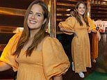 Binky Felstead wows in a bright yellow puff-sleeved dress as she attends a supplement tablet launch