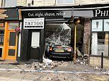 Moment 'drink driver' crashes through tattoo parlour window in high-speed smash before fleeing