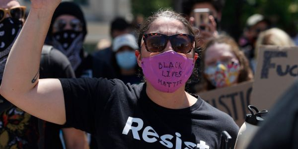 Law enforcement mysteriously seized hundreds of face masks that were being mailed to George Floyd protesters, rights group says