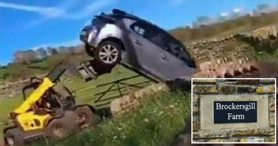 Man charged after car filmed being tossed into air by digger on farm