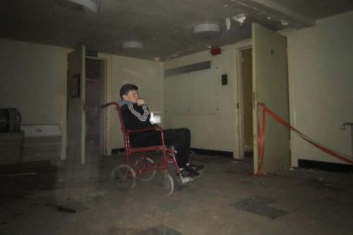 Scots capture eerie photo of 'ghost wearing white gown' in abandoned hospital
