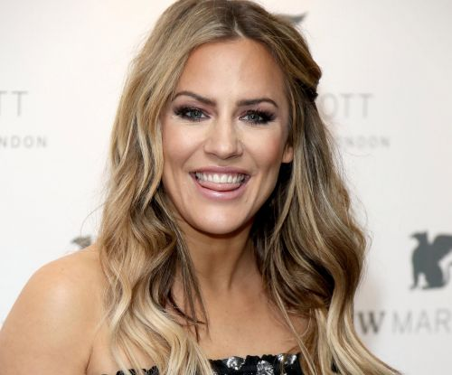 Caroline Flack drinks mugs of gravy like it's a cup of tea