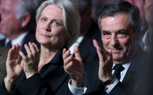 Former French PM Fillon and British wife face trial over 'fake jobs' scandal
