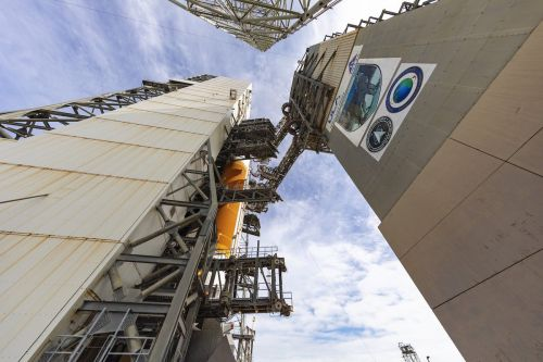 Mobile gantry wheeled away from Delta 4-Heavy rocket at Cape Canaveral