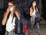 Jordana Brewster flashes a hint of her toned midriff in white waistcoat teamed with tartan trousers