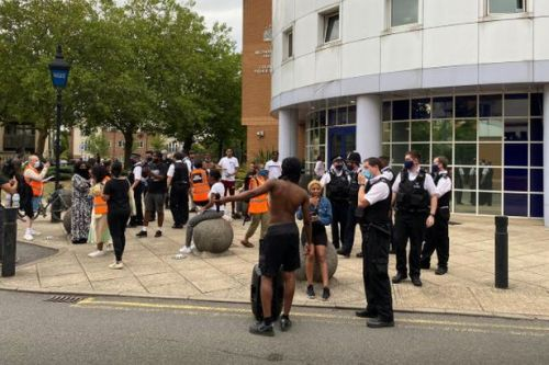 Protesters clash with police as crowd descends on station after boy arrested