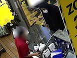 Masked man storms McDonald's with a knife and grabs a teenage worker around the neck during robbery