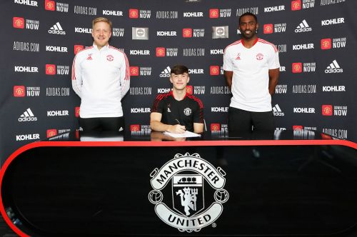 Manchester United youngsters Joe Hugill, Charlie McNeil and Paul Woolston sign new contracts