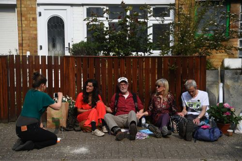 Climate protesters glue themselves together outside Jeremy Corbyn's house