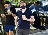 Jesse Tyler Ferguson and husband Justin Mikita mask up for their morning coffee run