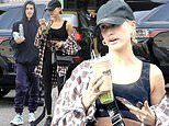 Hailey Bieber flaunts her toned figure in a sports bra while Justin heads to a dance studio in LA