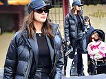 Irina Shayk rocks black leather pants with knee-high white boots for outing with daughter Lea