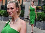 Karlie Kloss drapes stunning post-baby body in gleaming tight green dress as steps out on the town