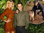 Ant McPartlin poses with a fan's pet pooch ahead of I'm A Celebrity final