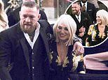 Conor McGregor and Dee Devlin put on a arrive at their sonRían's christening at the Vatican in Rome