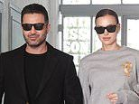 Irina Shayk holds hands with close male friend Ali Kavoussi during Milan Fashion Week