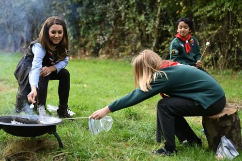 Kate toasts marshmallows with Scouts as she's handed important new royal role