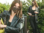 Kendall Jenner dons a chic look in all black as she covers up in a face mask on her way to dinner