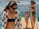 Binky Felstead slips into a bikini and palm print cover-up as she shares snap with daughter India