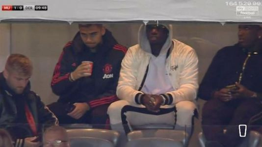 Paul Pogba watches Manchester United's clash with Derby with Luke Shaw in stands